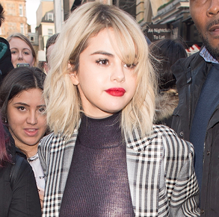 Selena Gomez wears see-through blouse, shows off boobs!