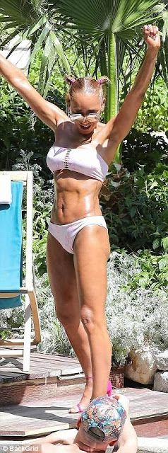 Mel B shows off her bikini body and eh...many fans think she needs more rest! (photos)
